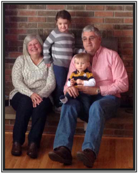 Joe and Cathy Young with grandchildren